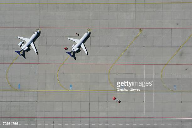 Aerial view of two airplanes parked in a row