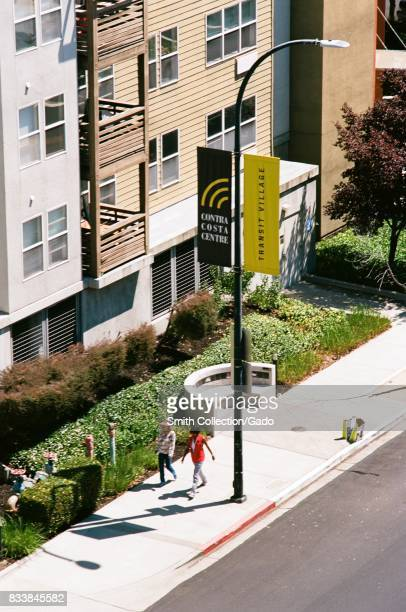 Aerial view of two people walking along a sidewalk in Contra Costa Center Transit Village an unincorporated division of Walnut Creek California July...