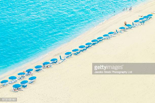 Aerial view of umbrellas and lawn chairs on beach