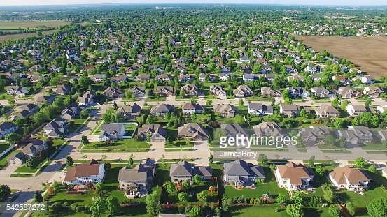 Aerial view of upper class neighborhood on sunny morning.