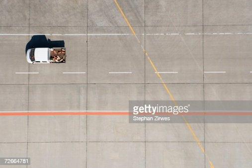 Aerial view of van driving across airport tarmac