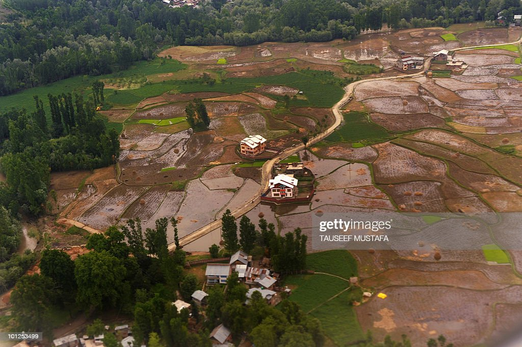 Aerial view of water logged fields on the outskirts of Srinagar on May 29, 2010. All major roads remain affected in the north western region due to heavy water logging and blocked drains after continuous rainfall for the last twelve hours, whereas the northern plains of India have experienced a heat wave believed to have contributed to over 100 deaths so far. AFP PHOTO/Tauseef MUSTAFA