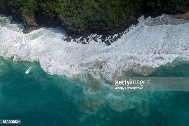 Aerial view of waves coming to cliff coast on Kauai, Hawaii, USA