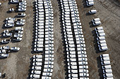 Aerial view of white cars parked in rows