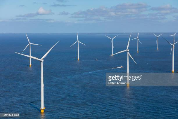 Aerial view of wind turbines at sea'n