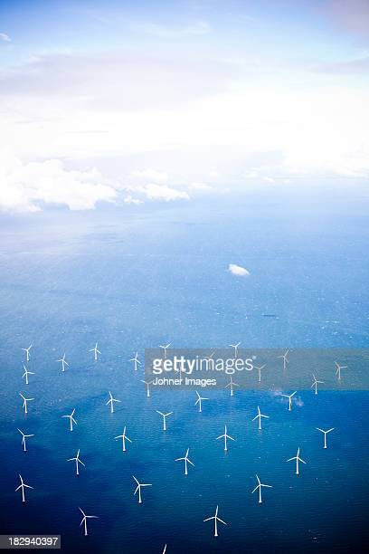 Aerial view of wind turbines in sea