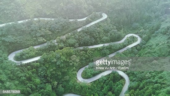 Aerial View Of Winding Road In Forest