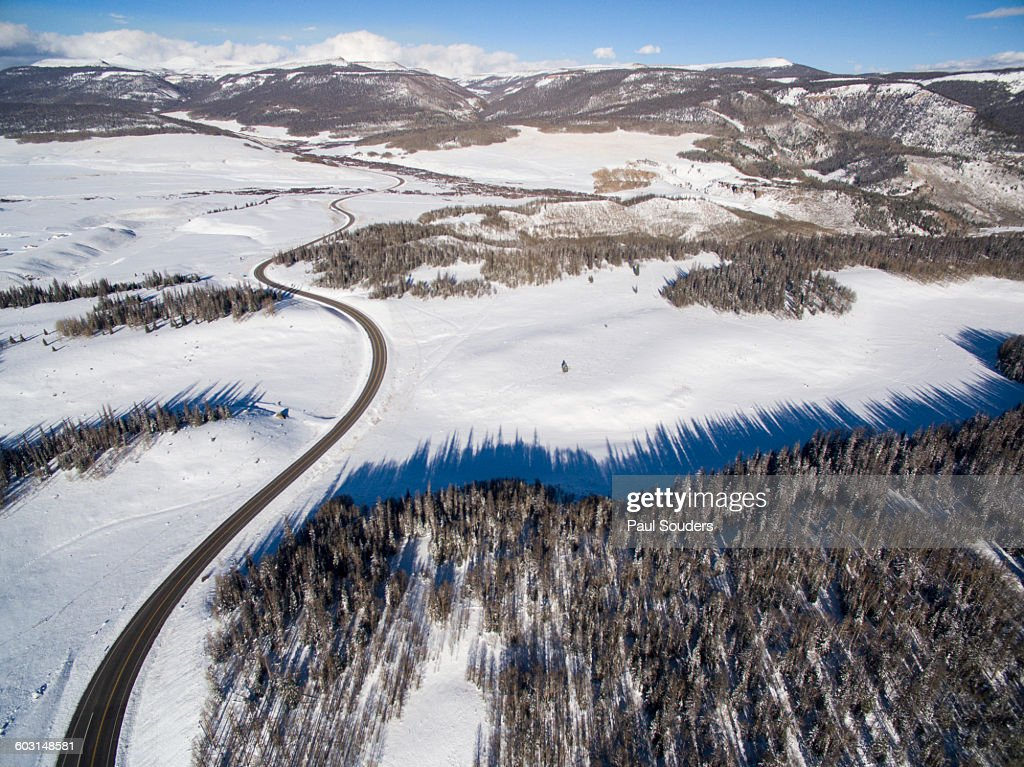 Aerial View of Winding Road in Snow, Colorado, USA