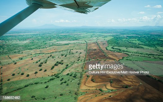 Aerial view of wing over farm lands : Stock Photo