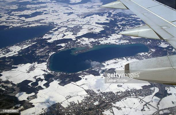 Aerial view (out of aeroplane, with wing) of Woerthsee and environs in winter; Starnberg district / county, Upper Bavaria, Germany
