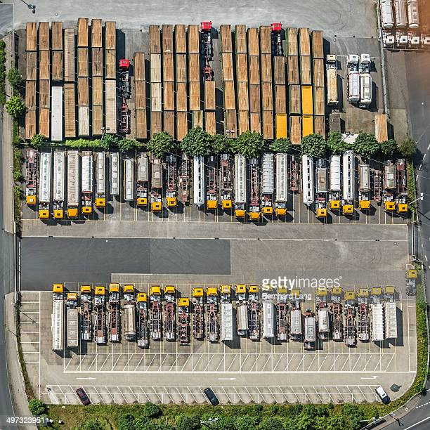Aerial view of yellow trucks and truck trailers