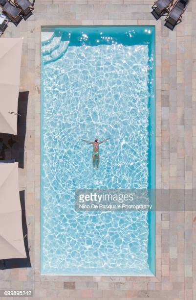Aerial view of young man into swimming pool