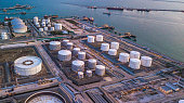 Aerial view oil terminal is industrial facility for storage of oil and petrochemical products ready for transport to further storage facilities.