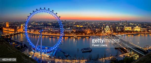 Aerial view on Houses of Parliament and London Eye observation wheel