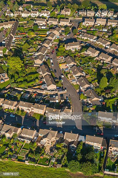 Aerial view over family homes neat suburban streets