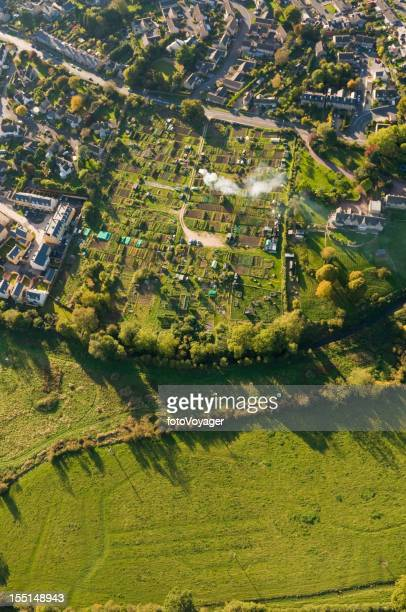 Aerial view over homes gardens summer fields
