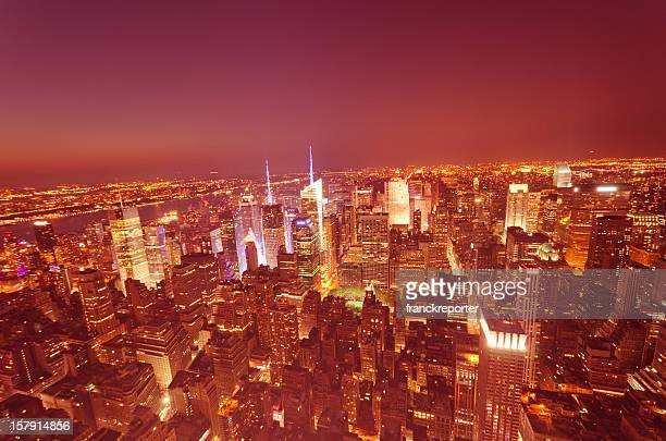 Aerial View over Manhattan Skyline illuminated in night