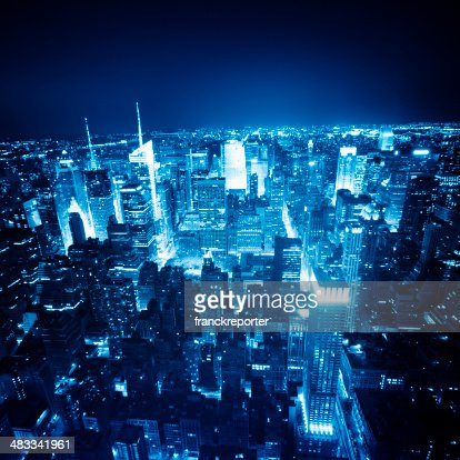 Aerial View over Manhattan Skyline in the night - NYC