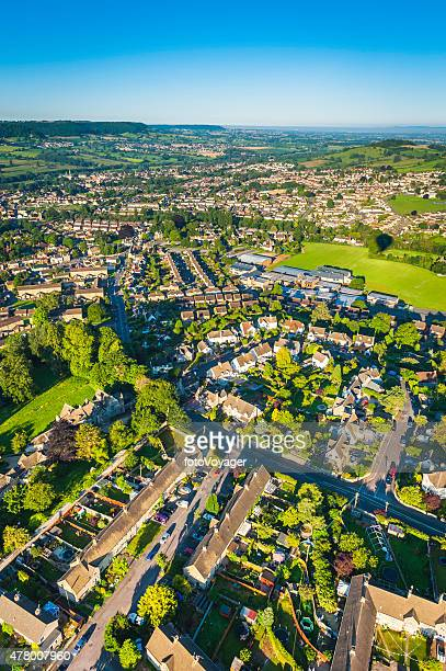 Aerial view over suburban family homes green gardens country town