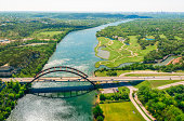 Aerial view from helicopter of 360 bridge on Colorado River near Austin Texas.