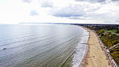 Aerial View Image of English Seaside Beach of Bournemouth City Coast feat Skyline and Clouds, UK
