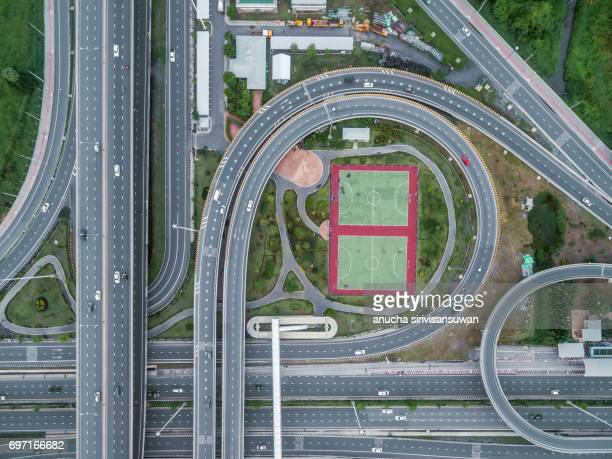 Aerial view roundabout road have public park , top view , thailand .