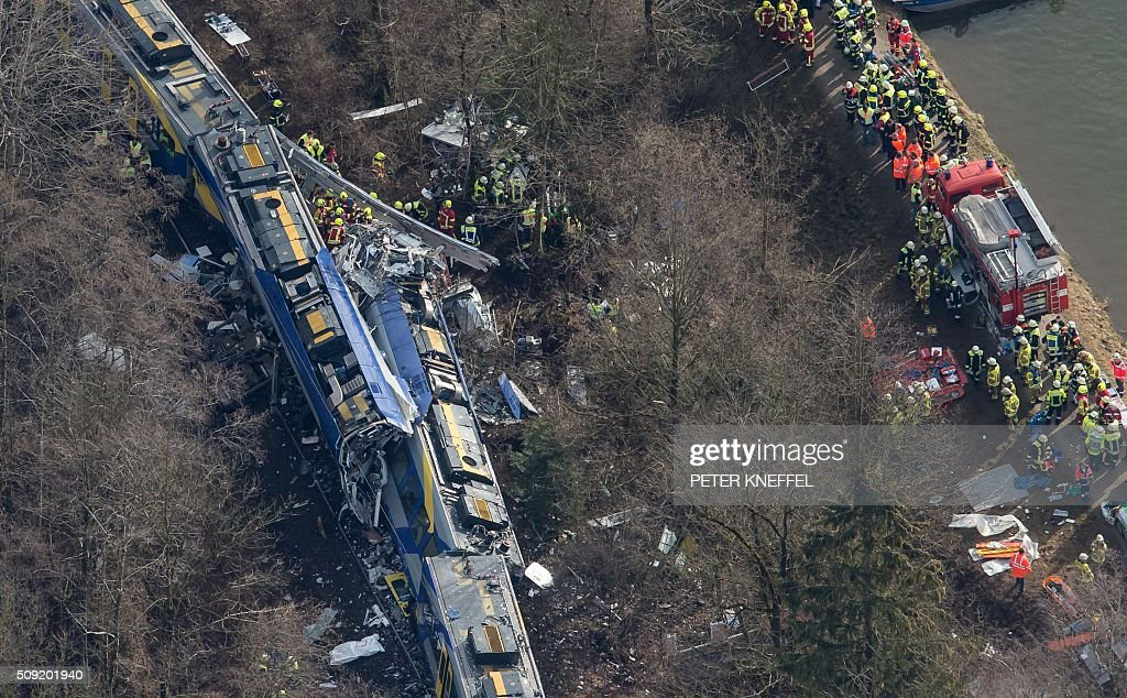 Aerial view shows firefighters and emergency doctors working at the site of a train accident near Bad Aibling southern Germany on February 9 2016 Two...