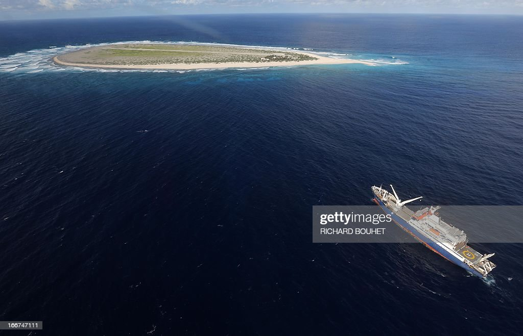 Aerial view shows the Marion Dufresne vessels and the Tromelin Island on April 16, 2013. French Minister for Overseas Territories Victorin Lurel, defended the 'French presence' on 'extreme land' during a visit to the tropical islands of Glorieuses and Tromelin managed by the Lands Administration French Southern and Antarctic Territories (TAAF). AFP PHOTO / RICHARD BOUET