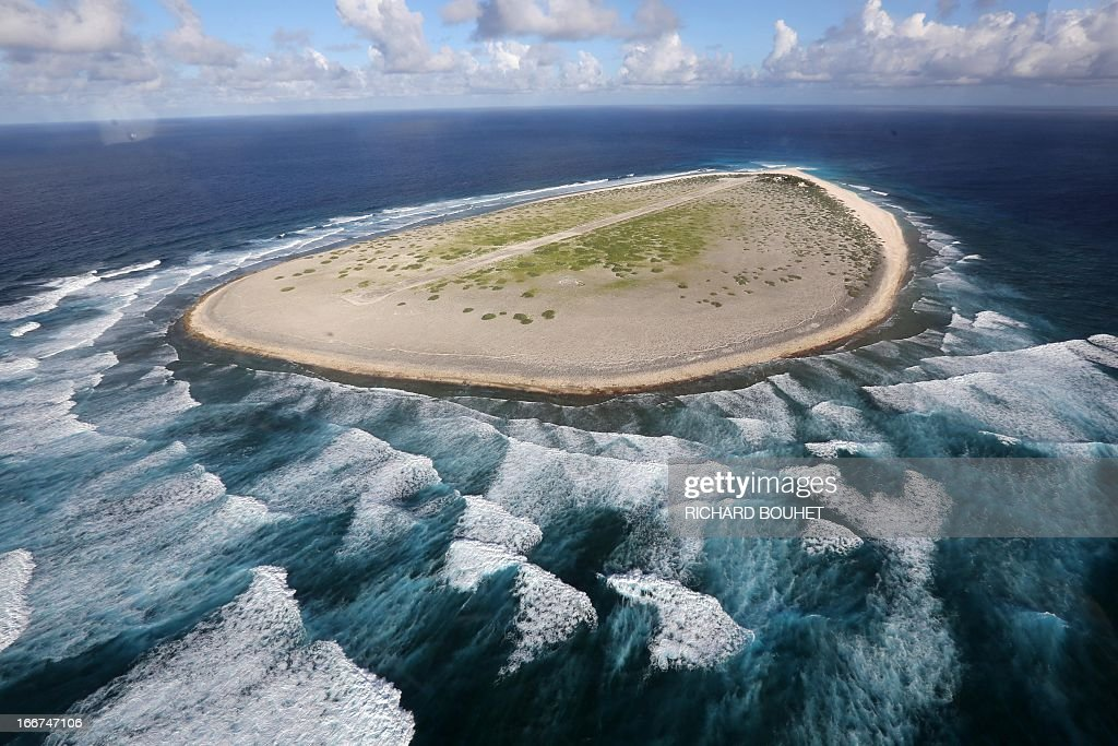 Aerial view shows the Tromelin Island on April 16, 2013. French Minister for Overseas Territories Victorin Lurel, defended the 'French presence' on 'extreme land' during a visit to the tropical islands of Glorieuses and Tromelin managed by the Lands Administration French Southern and Antarctic Territories (TAAF). AFP PHOTO / RICHARD BOUET