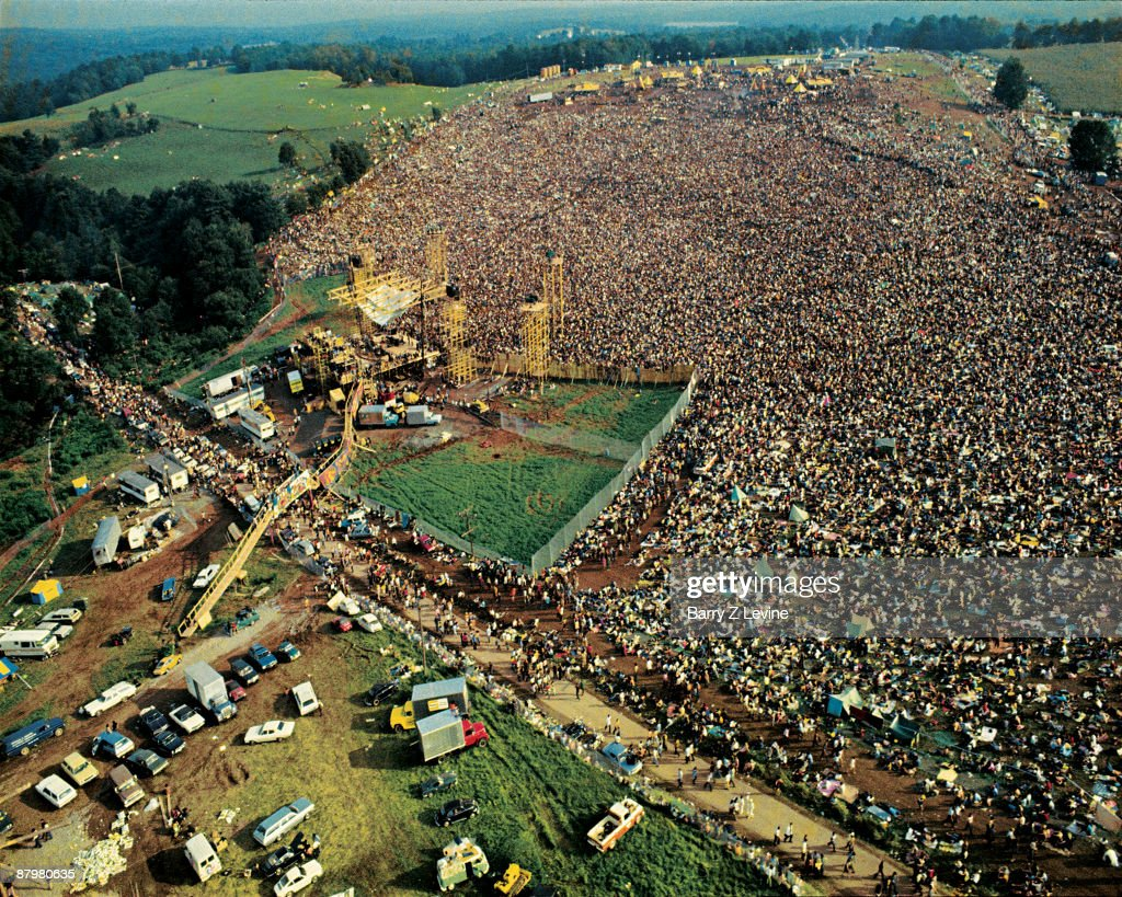 Aerial view taken from a helicopter of the stage and the five hundred thousand strong crowd gathered at the Woodstock Music and Arts Fair in Bethel, New York, August 15 - 17 (and part of the 18th), 1969.