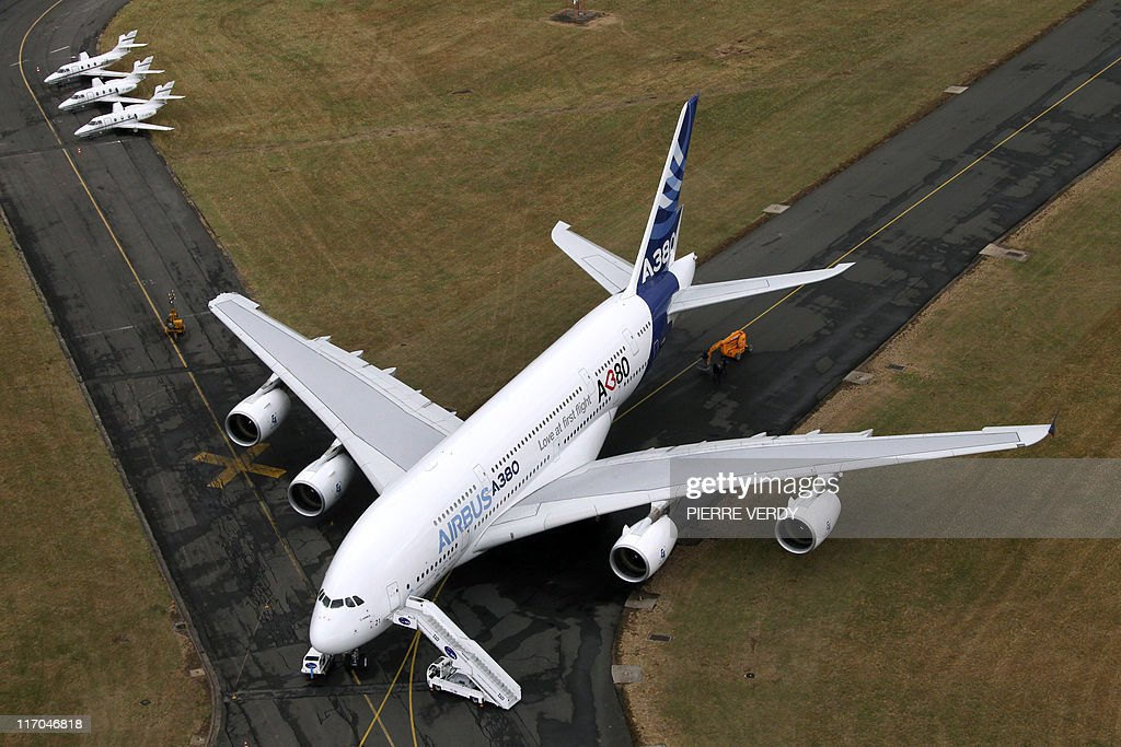 Aerial view taken from an Eurocopter helicopter show the tarmac of the Bourget Airport with the demonstration version of the Airbus A 380, which clipped a structure damaging the right wing, by the taxiway on sunday, during the first day of the International Paris Air Show on June 20, 2011. The show will be open to the public from June 24 to 26. AFP PHOTO PIERRE VERDY