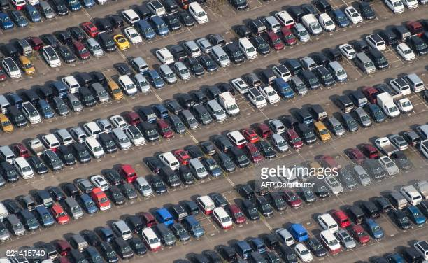 Aerial view taken from an ultralight aircraft shows cars of German car maker Volkswagen standing on a parking site of the company's plant in...