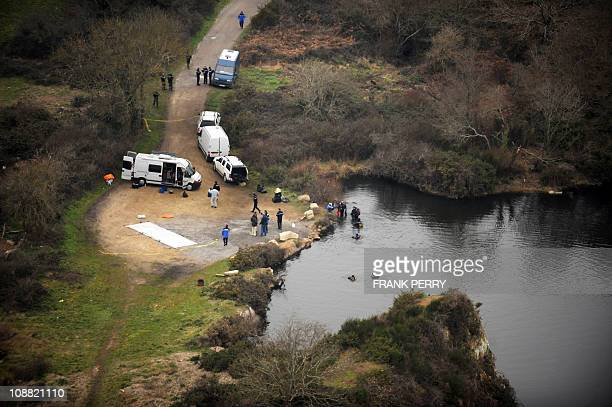 A aerial view taken on February 1 2011 shows policemen searching the body of 18yearold Laetitia Perrais in LavausurLoirePresident Nicolas Sarkozy was...