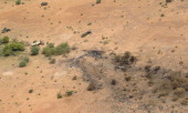 Aerial view taken on July 26 2014 shows the crash site of the Air Algerie Flight AH 5017 in Mali's Gossi region west of Gao UN experts investigating...