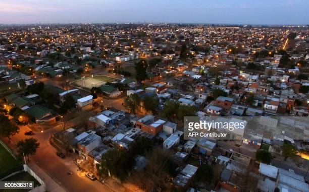 Aerial view taken on June 23 2017 of the La Granada slum which is next to the venue where Barcelona's football star Lionel Messi of Argentina and...