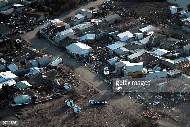 Aerial view taken on March 4 of the damages caused by the tsunami in Tubul 50 km away from Concepcion Chile after the quake that hit the country last...