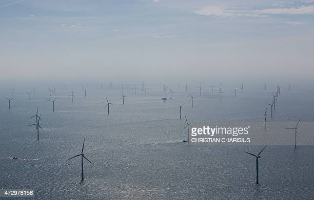 Aerial view taken on May 11 2015 shows windmills of the 'Nordsee Ost' wind park off the coast of the North Sea island of Helgoland northern Germany...
