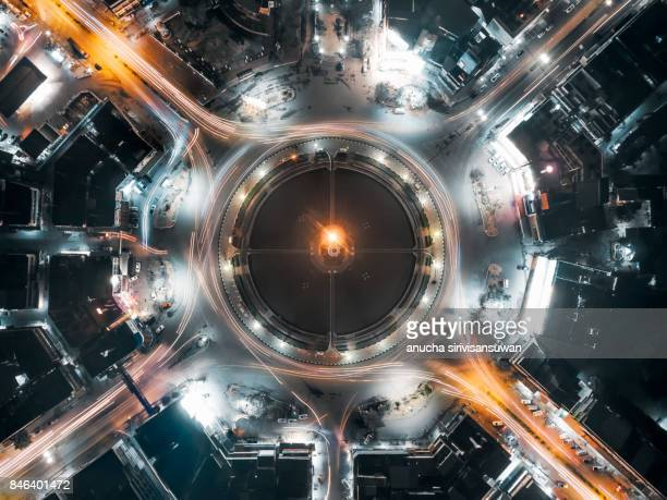 aerial view traffic circle and in city light speed at night , thailand .
