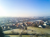 Aerial view over Rommelsbach, northern district of Reutlingen on a sunny winter morning with hoarfrost on the meadows and gardens, Reutlingen, South Germany, Baden Württemberg, Germany.