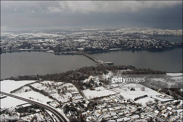 Aerial views of the Mont SaintMichel and Saint Malo under the snow In France On February 27 2004Saint Malo valley of the Rance and dam of the tidal...