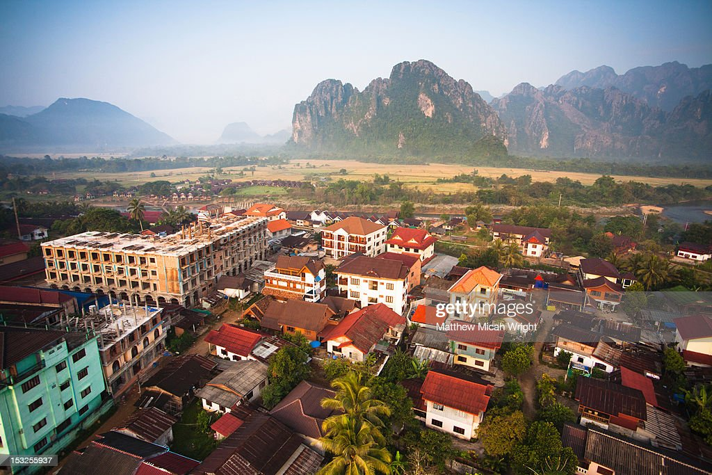Aerial views over the city of Vang Vieng.
