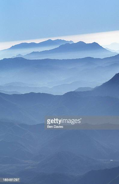 Aerial views over the Cordillera mountain range in central Laos now covered in clouds and mist The country boasts some of the most panoramic and...