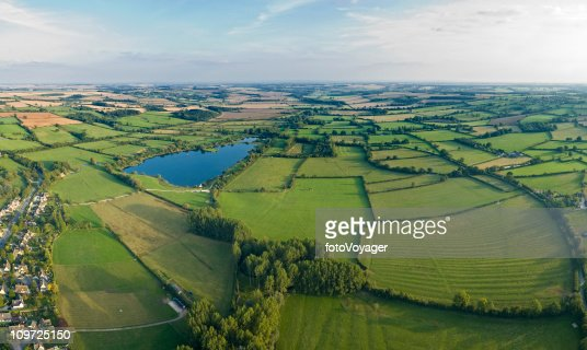 Aerial vista over farm and village : Bildbanksbilder