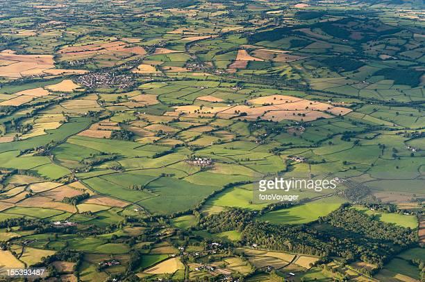 Aerial vista over patchwork summer landscape
