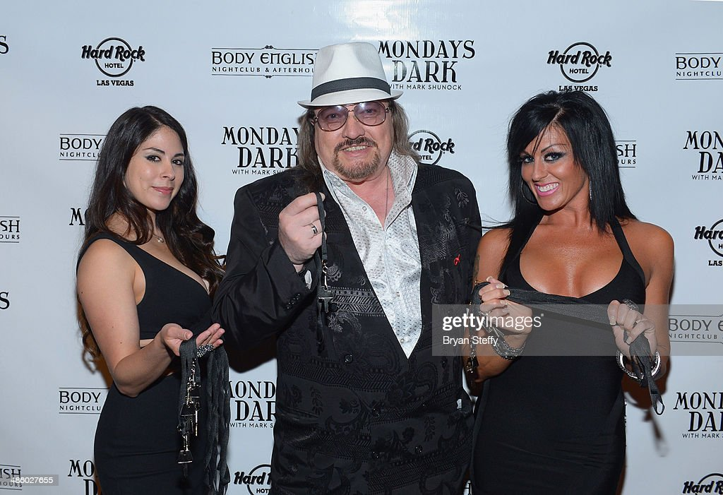 Aerialist Erica Vanlee, singer Marc Love and dancer Jennifer Romas arrive at 'Mondays Dark With Mark Shunock' benefiting the Miracle League of Las Vegas featuring music from movie soundtracks at the Body English nightclub inside the Hard Rock Hotel & Casino on April 21, 2014 in Las Vegas, Nevada.