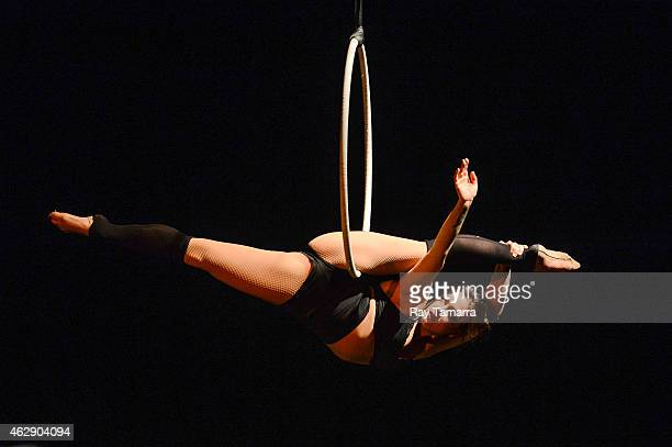 Aerialist Stephanie Bailey performs on the Lyra at the 2015 US Aerial Championship at Rose Nagelberg Theater on February 6 2015 in New York City