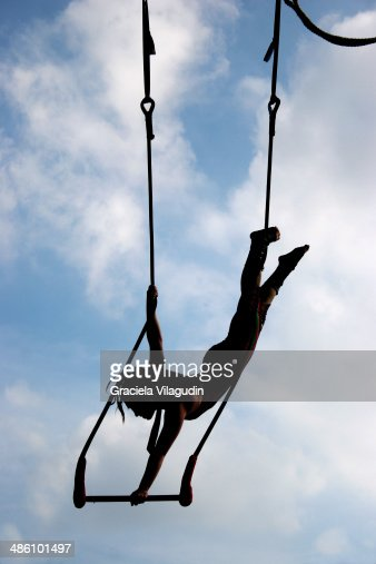 Aerialist woman in a trapeze