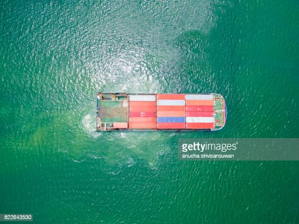 aeriel view container shipping by Small transport container ship by green sea .