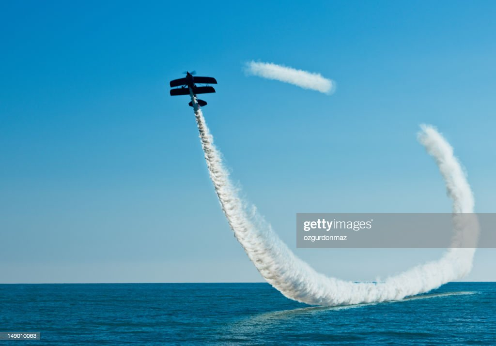 Aerobatic biplane on the sky