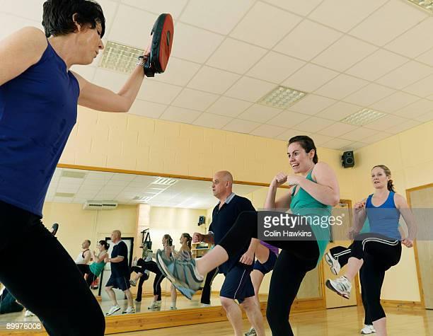 aerobic kick exercise at gym